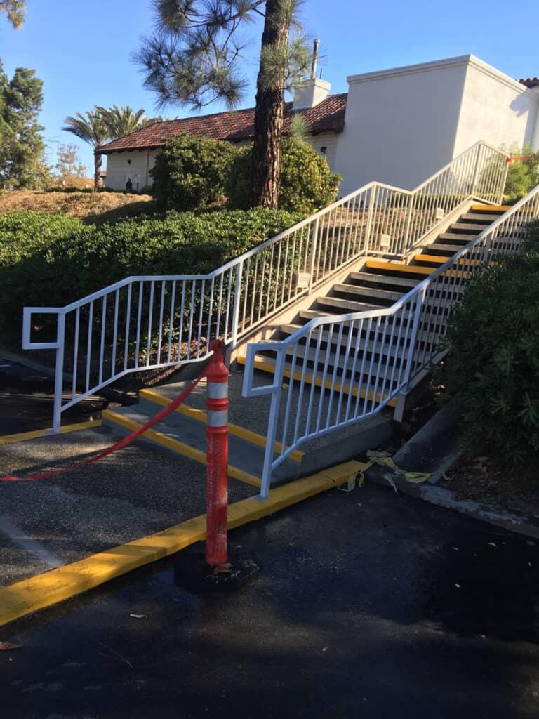 white iron stair hand rail